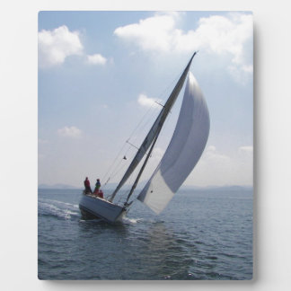 Racing yacht at speed. plaque