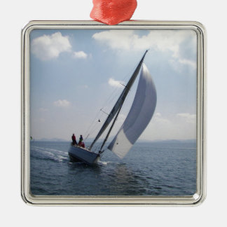 Racing yacht at speed. Silver-Colored square decoration