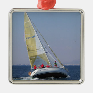 Racing yacht from behind. Silver-Colored square decoration