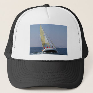 Racing yacht from behind. trucker hat