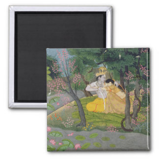 Radha and Krishna embrace in a grove of flowering Square Magnet