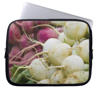 Radishes on display at farmer's market laptop sleeve