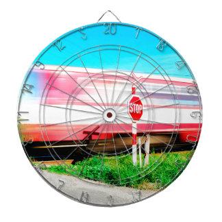 Railroad crossing dartboard with darts
