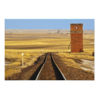 Railroad tracks lead to old granary at Collins Photo Print