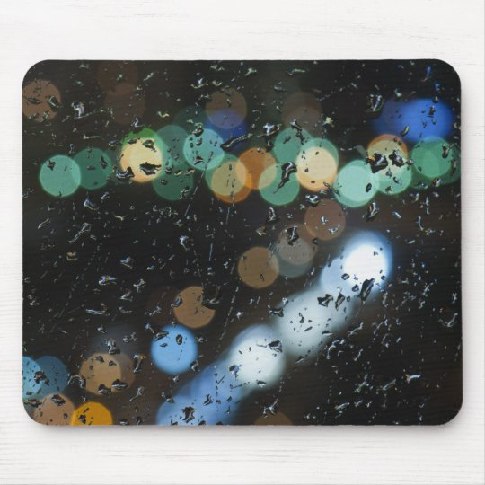 Rain drops on the window's glass mouse mat