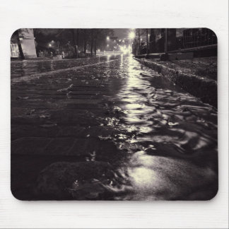 Rain water flowing on the streets of Helsinki Mouse Mat