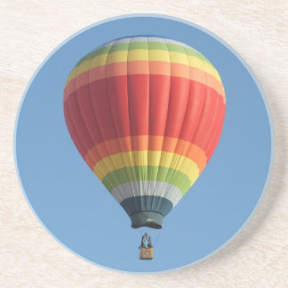 Rainbow colored hot air balloon drink coaster