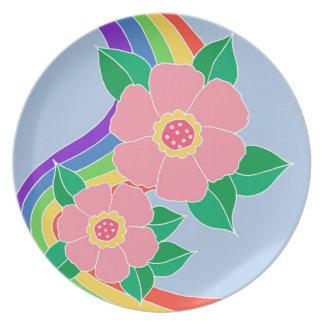 Rainbow flowers on blue plates