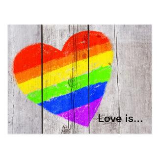 Rainbow heart on a grungy wood panel postcard
