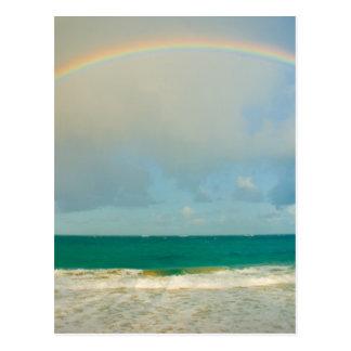 Rainbow over ocean postcards