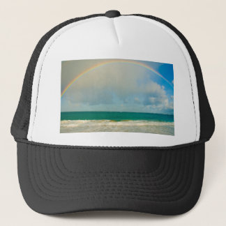 Rainbow over ocean trucker hat