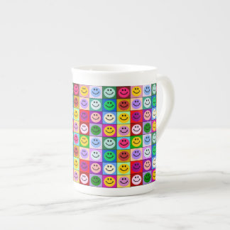 Rainbow smiley face squares tea cup