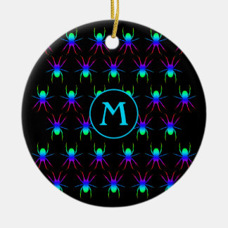 Rainbow spiders monogram on black round ceramic decoration