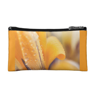 Raindrops on a yellow winter flower cosmetics bags