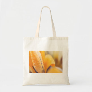 Raindrops on a yellow winter flower tote bag