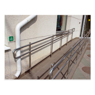 Ramp for physically challenged with metal railing postcard