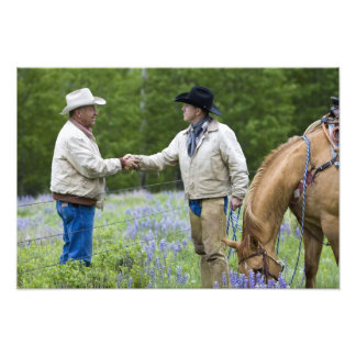Ranchers shaking hands across the fencing in photo art