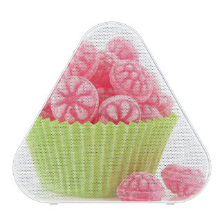Raspberry tasty candy sweets in green cup cake