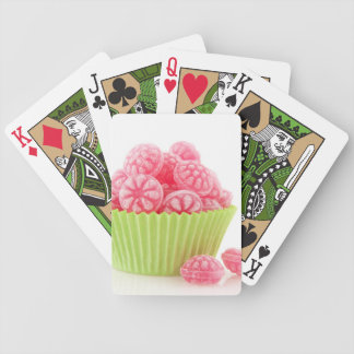 Raspberry tasty candy sweets in green cup cake bicycle playing cards