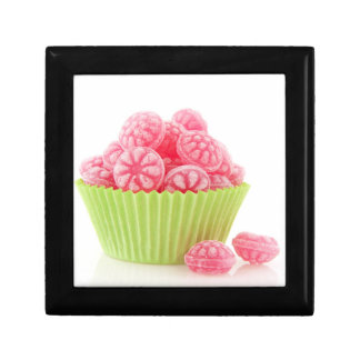 Raspberry tasty candy sweets in green cup cake gift box