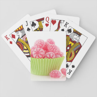 Raspberry tasty candy sweets in green cup cake playing cards