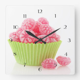 Raspberry tasty candy sweets in green cup cake square wall clock