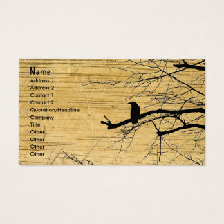 Raven on the Tree with wooden background