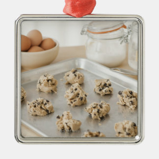 Raw cookies on baking tray christmas ornament
