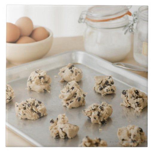 Raw cookies on baking tray ceramic tiles