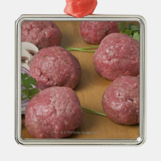 Raw meatballs on a cutting board christmas ornament