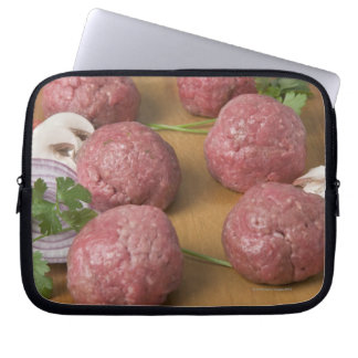 Raw meatballs on a cutting board laptop sleeve