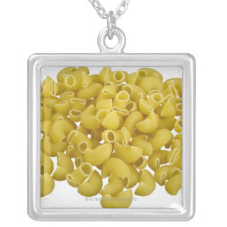 Raw pasta isolated on white background silver plated necklace