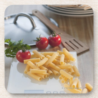 Raw pasta on weight scale coaster