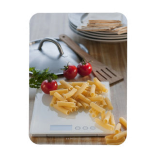 Raw pasta on weight scale rectangular magnets