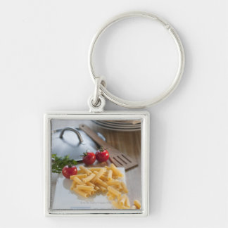 Raw pasta on weight scale key chain