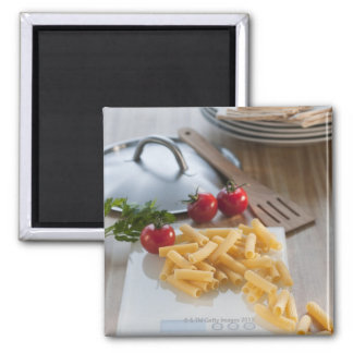 Raw pasta on weight scale fridge magnet