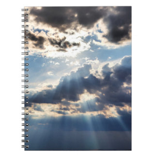 Rays of sunshine from above notebooks