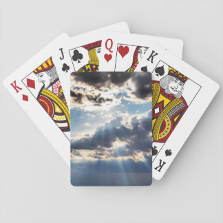 Rays of sunshine from above playing cards