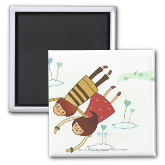 Rear view of a couple flying together square magnet