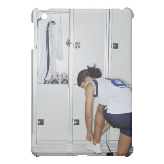 Rear View of a Female Volleyball Player Tying iPad Mini Cover