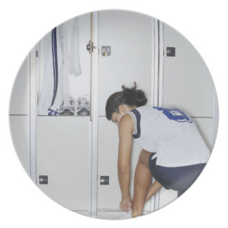 Rear View of a Female Volleyball Player Tying Party Plates
