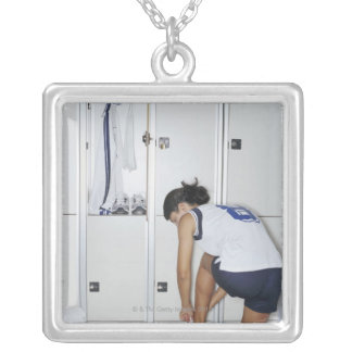 Rear View of a Female Volleyball Player Tying Silver Plated Necklace