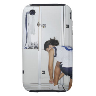Rear View of a Female Volleyball Player Tying Tough iPhone 3 Case