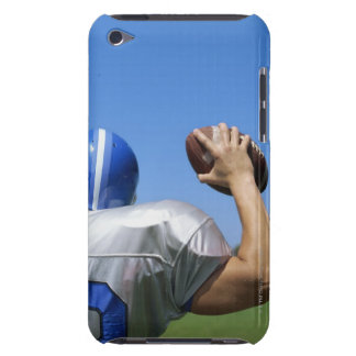 rear view of a football player throwing a iPod touch cover