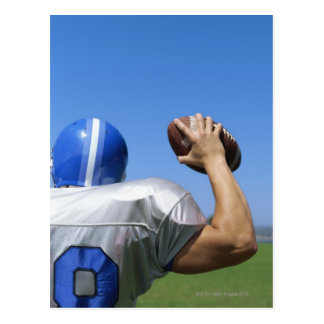 rear view of a football player throwing a postcard