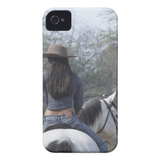 Rear view of a woman riding a horse Case-Mate iPhone 4 cases