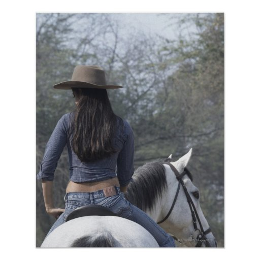 Rear view of a woman riding a horse print