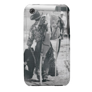 Rear view of cowboy hauling gear iPhone 3 cases