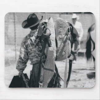 Rear view of cowboy hauling gear mouse mat