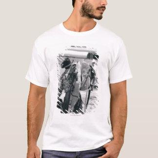 Rear view of cowboy hauling gear T-Shirt